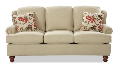 Traditional Wing Back Sleeper Sofa With Turned Wood Feet