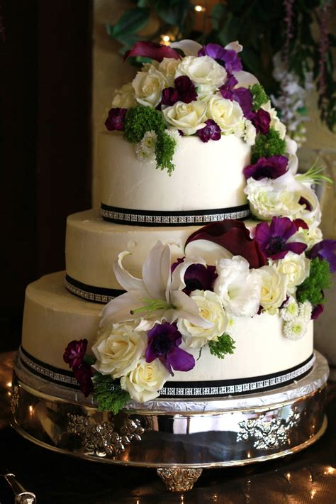 exquisite cookies  tier wedding cake  fresh flowers