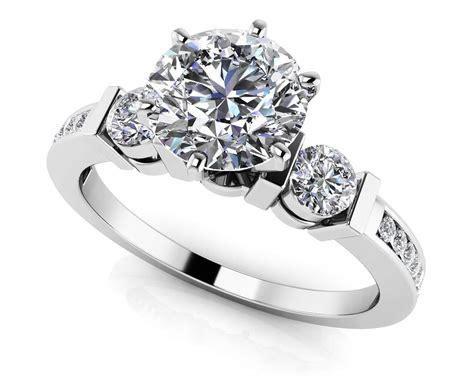 triple diamond channel engagement ring