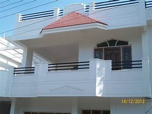 A Duplex house ,Balcony with Sloped roof &Wooden door