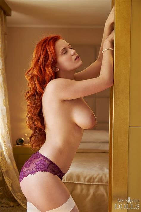 Curvy Redhead Wearing White Stockings