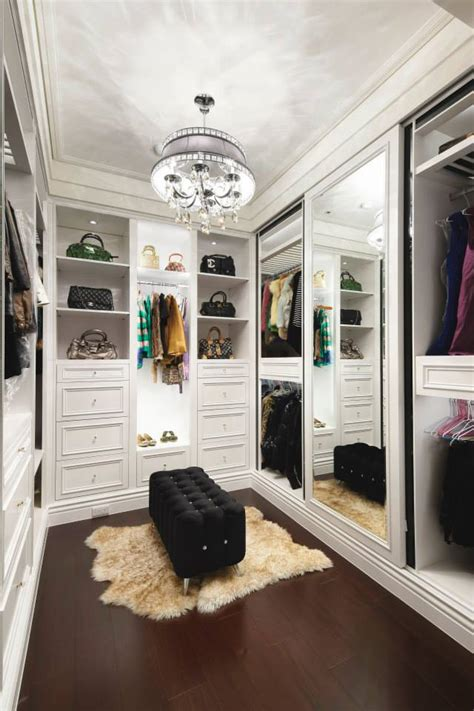 white walk in closet with a mirror doors home decoz