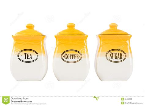 white ceramic kitchen canisters pots of tea coffee and sugar yellow white color on a