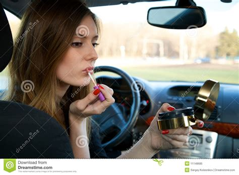 The Person To Make A Car by Preparing Make Up In Car Stock Image