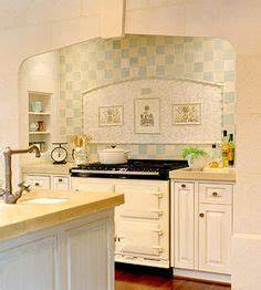 smaller mosaic tiles just behind stove with larger more With what kind of paint to use on kitchen cabinets for mosaic wall art kits