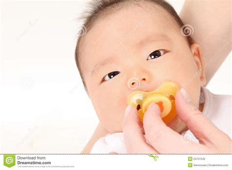 Infants And Pacifier Stock Photography Image 24737242