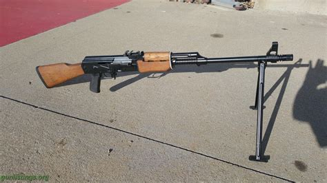 Made from baltic birch laminate wood. Gunlistings.org - Rifles Yugo RPK M72
