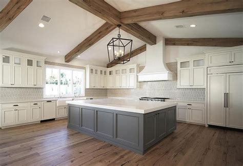 important features in kitchen island lovely kitchen features a darlana large lantern hanging over a gray kitchen island topped with