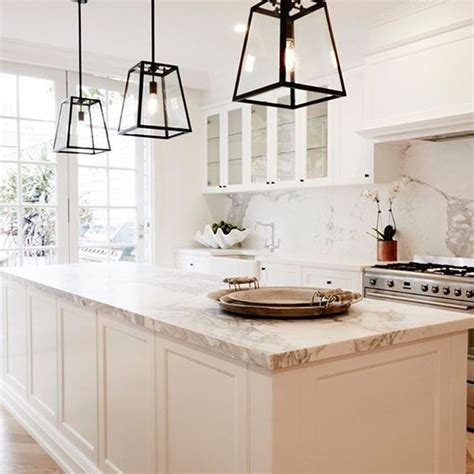 white kitchen pendant lights how to htons kitchen with a modern take 1396