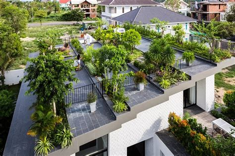 house with rooftop garden house in vietnam with a green rooftop garden
