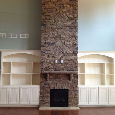 story stone fireplace  built ins   side