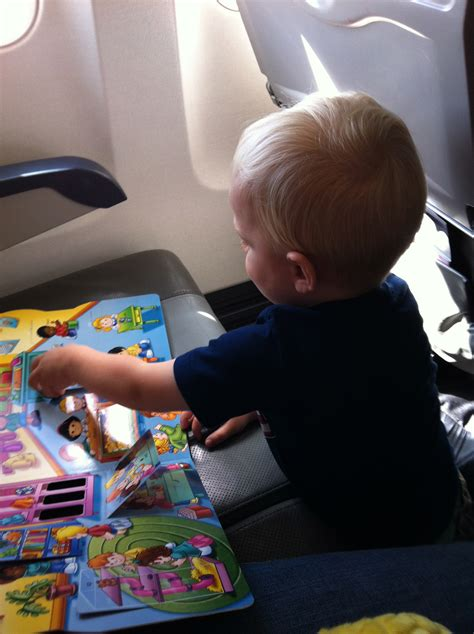 8 Tips For Airplane Travel With Kids North Of Something