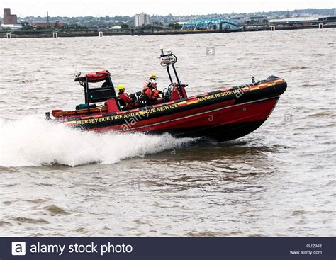 Boat Service Liverpool by Merseyside And Rescue Service Boat On The River