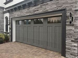 Faux carriage garage doors astonishing carriage style for Carriage style garage doors cost