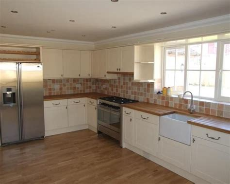 wooden kitchen floors wood floor countertops with white cabinets want 1170