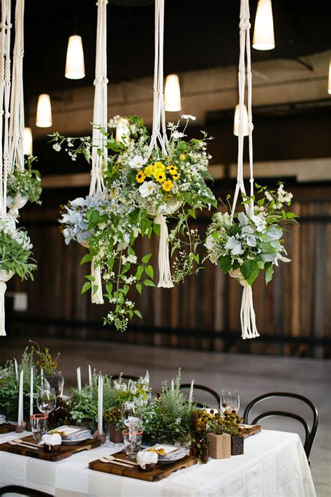 hanging floral centerpieces the macrame wedding 10 knotty wedding decor ideas