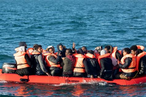 Desperate faces of migrants making the perilous journey to ...