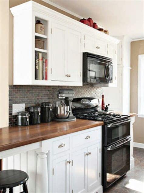 black appliances  hard contrast  white cabinets