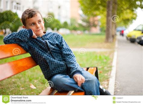 Child On A Bench In A Park Royalty Free Stock Photography