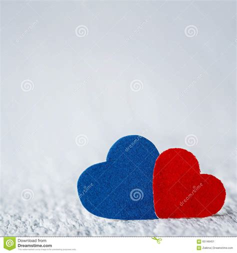 red heart  blue heart  white wood background