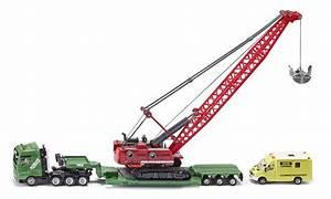 Schwertransport mit Seilbagger und Begleitfahrzeug