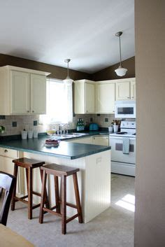 pictures of kitchens with white cabinets and black appliances the quot l quot shaped house painting day 44 white trim w non 9944