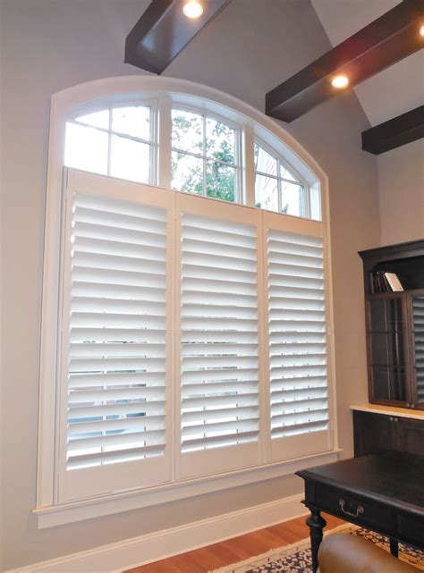 shutters   louvers   large arch window arched