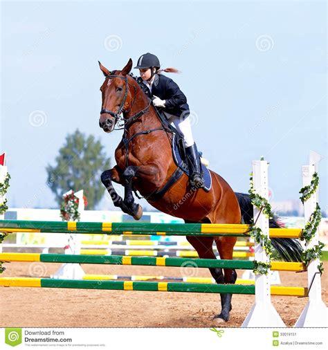 obstacle horse overcoming equestrianism horsewoman riding sport equestrian sports horseback hindernis overwinnen het een jumping racing cheval ostacolo superamento surmonter