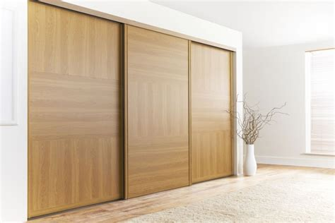 oak wooden sliding doors for simple bedroom decorating