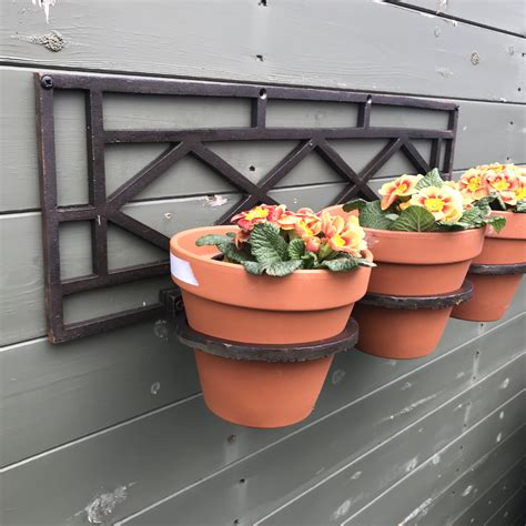 flower pot holder wall mounted part   rustic merchants range  rustic candle holders