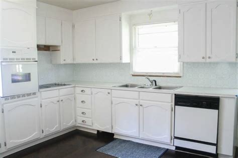 painted white oak kitchen cabinets painting oak cabinets white an amazing transformation 7317