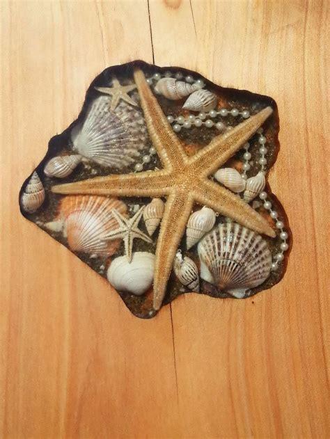 artists fill tables cracks  sea shells stones