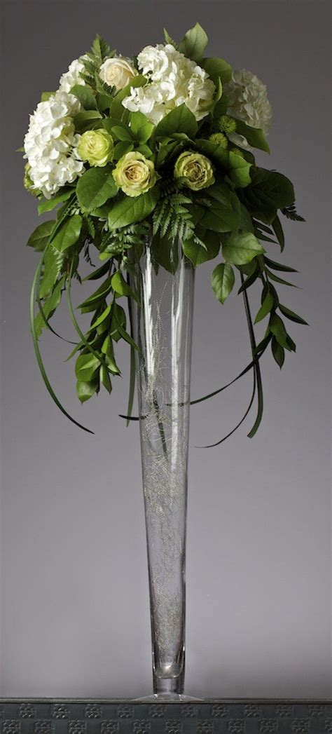 ideas for floral arrangements in vases 25 best ideas about tall vases on pinterest tall vases wedding wedding floral arrangements