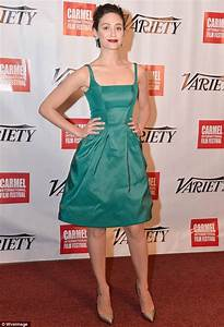 Emmy Rossum displays her trim figure in a charming jade ...