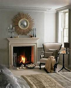 Sunburst mirror over fireplace mantel bedroom