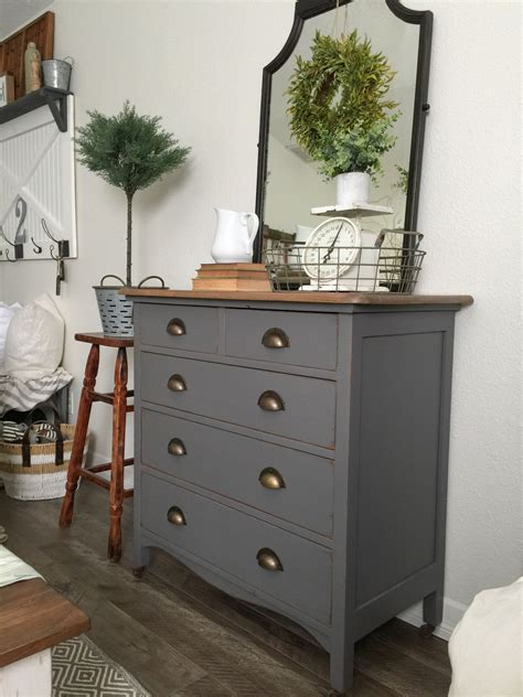 charcoal gray dresser with a sweet little note painting