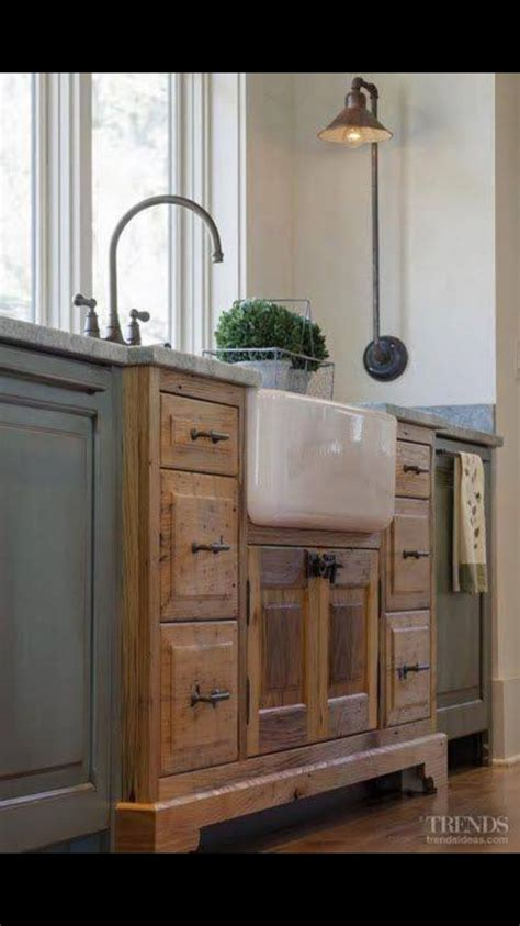 kitchen cabinets that look like furniture like how the sink looks like furniture built into the