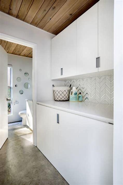 white  silver herringbone laundry backsplash tiles