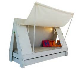 trundle bed for children creatively closes into tent with light