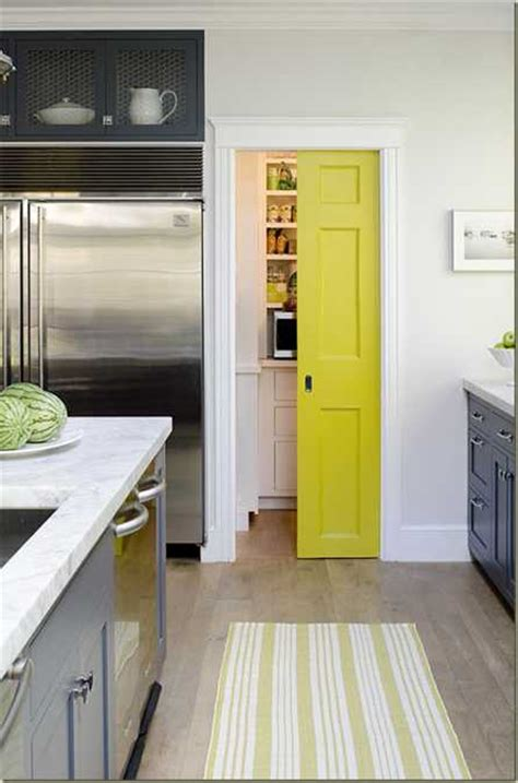 yellow color accents jazz  elegant dark gray kitchen