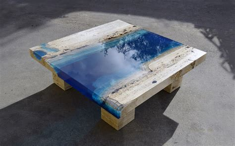lagoon tables in travertine marble and resin by la table homeli
