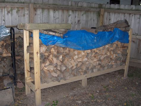 build a rack 14 easy diy outdoor firewood racks to keep those logs