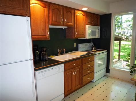 kitchen island with black granite top before and after remodeling photos kitchen makeovers