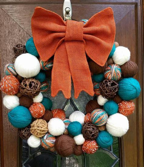 brown burnt orange teal  cream autumn yarn ball wreath  burnt orange burlap bow