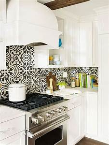Stylish backsplash pairings kitchens cement and black for Kitchen cabinets lowes with mexican tile wall art