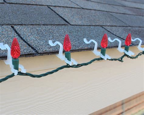 how to put christmas lights on roof how to professionally hang holiday lights eclean magazine