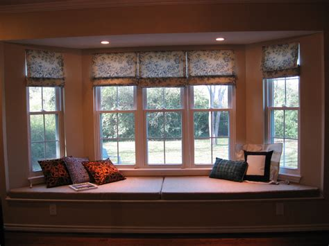 luxurious bay windows with wooden framed windows and glass