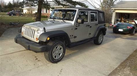 sell   jeep wrangler  unlimited sport  wd