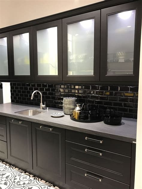black kitchen cabinets  subway tiles  white frosted