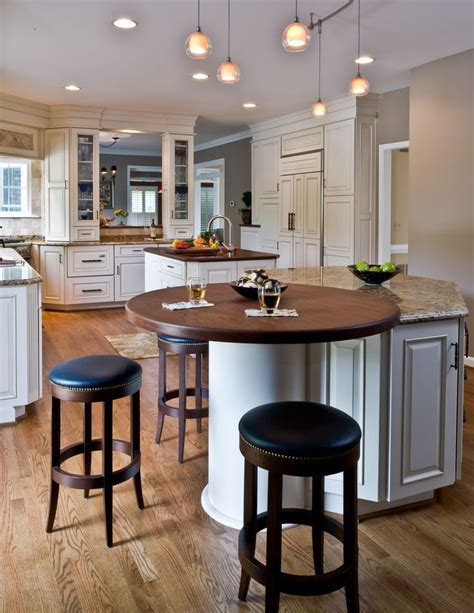 Traditional kitchen  round wood top on island end; tall